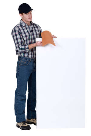 Roofer stood with tile and poster Stock Photo - 19845769