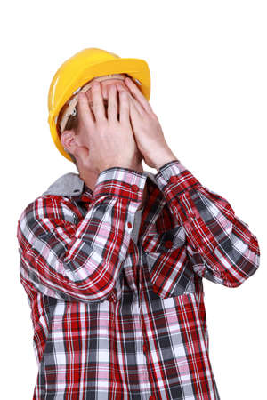 devastated: Devastated construction worker