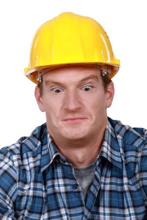 journeyman technician: Shocked builder Stock Photo