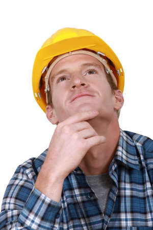 A thoughtful construction worker. photo