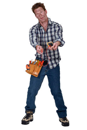 disoriented: A disoriented man holding a multimeter