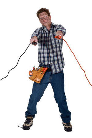 electrical fire: Man holding electrical clamps
