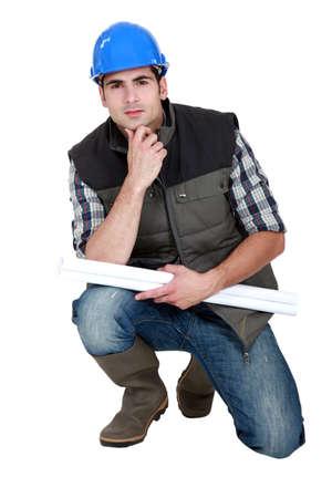 kneel: A pensive tradesman