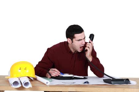 delirious: Architect shouting down the telephone