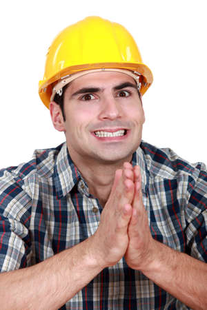 Builder hoping everything goes as planned Stock Photo