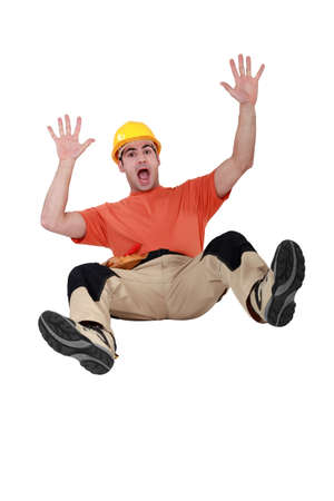 Tradesman falling backwards photo