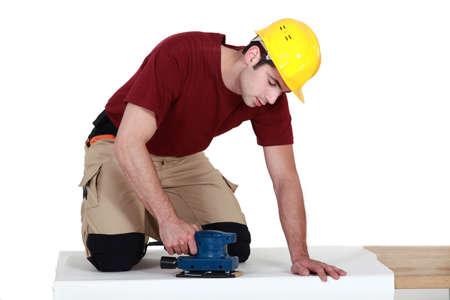 sander: Man using a sander