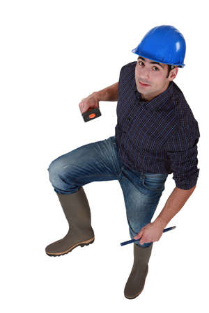 Construction worker in wellington boots photo