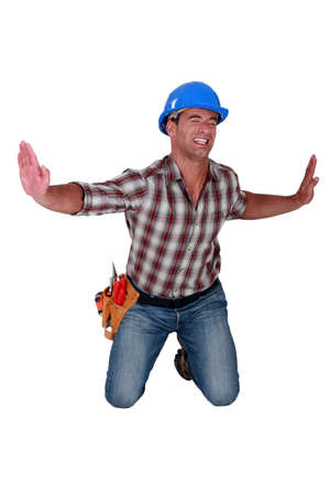 forcing: Man forcing invisible walls apart Stock Photo