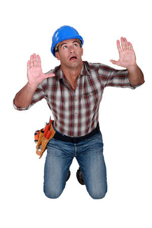 terrorized: Tradesman surrounded by an invisible wall