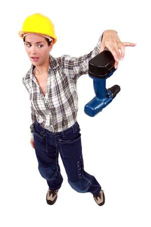 inoperative: craftswoman throwing away her drill