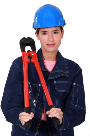 Women with pliers resting on the shoulder Stock Photo - 19878185