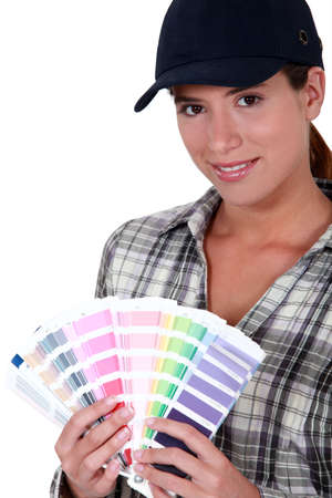 Painter holding a spectrum of colour samples photo