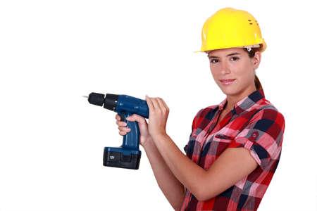 tradeswoman: Tradeswoman holding a power tool Stock Photo