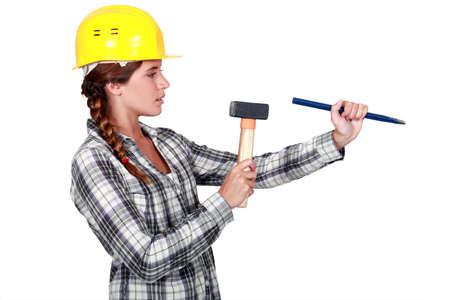 wedge: craftswoman holding a wedge and a hammer Stock Photo