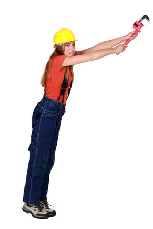 clutching: Tradeswoman hanging on for dear life Stock Photo