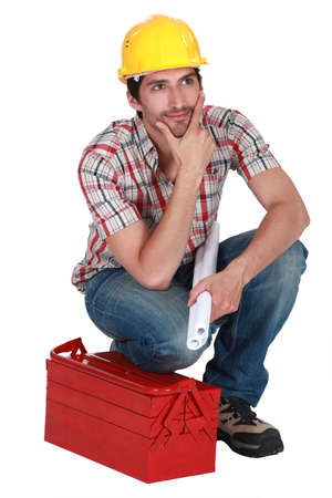 Dreamy tradesman staring off into space Stock Photo - 19874143