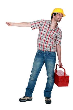 pull along: Tradesman pulling a heavy object