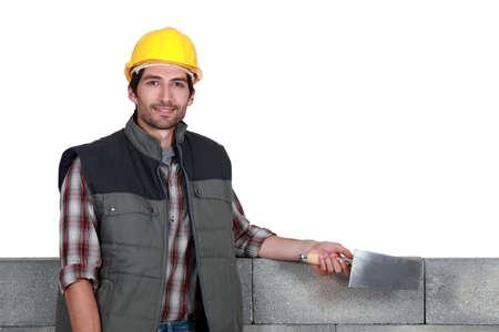 stonemasonry: A stonemason holding a trowel Stock Photo