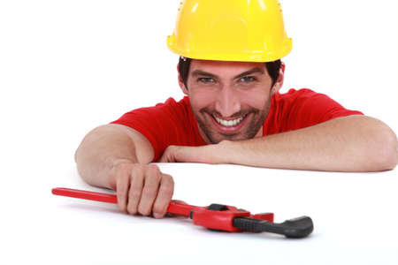 hilarity: Laughing worker with a wrench Stock Photo