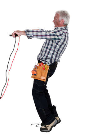 Man using battery clips photo