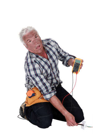 A mature shocked electrician. photo