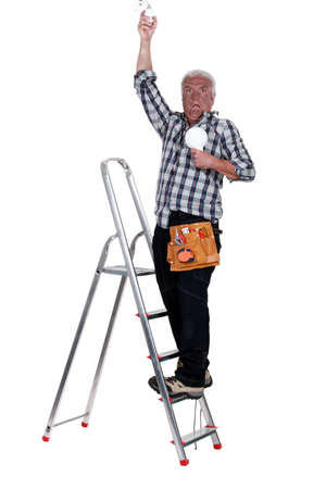 convulsion: electrician on a ladder having an electric shock