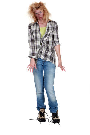 electric shock: Electrocuted woman having difficulty walking Stock Photo
