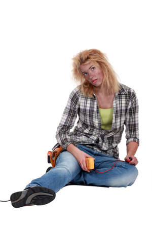 clumsy: Clumsy woman electrician Stock Photo