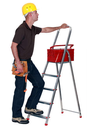 Man with a toolbox and stepladder