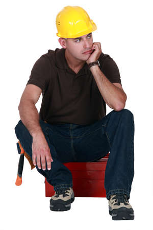 envisage: craftsman in a deep reflection Stock Photo