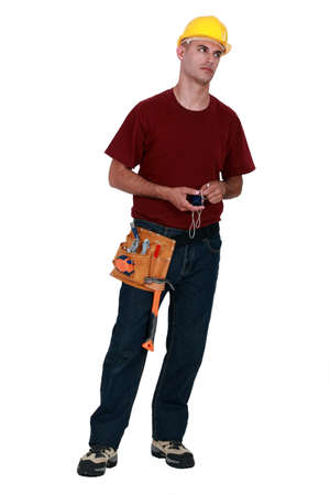 fedup: A very annoyed tradesman holding a chalk line Stock Photo