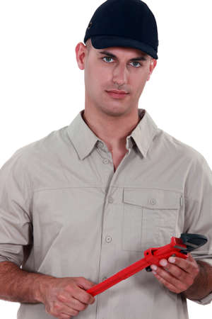 purposely: Handyman holding a pipe wrench