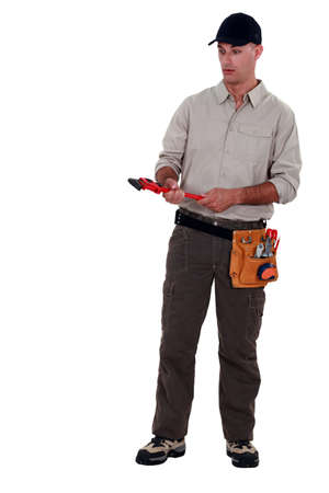 novelty: Amazed man holding a pipe wrench