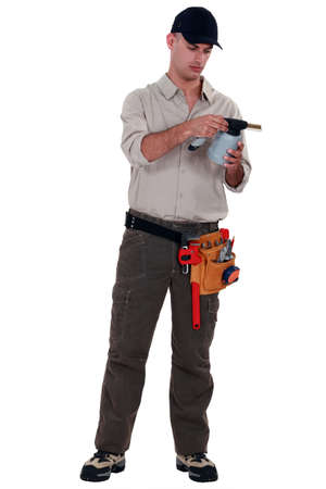 Man reading blow torch instructions Stock Photo - 19791233