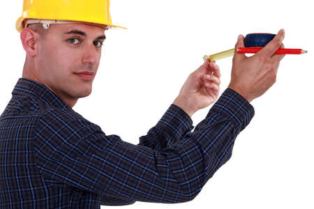 Tradesman using a measuring tape Stock Photo - 19791315