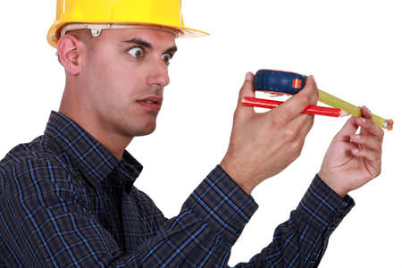 impressed: A construction worker impressed by his meter.