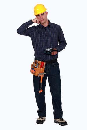sander: Woodworker holding a sander
