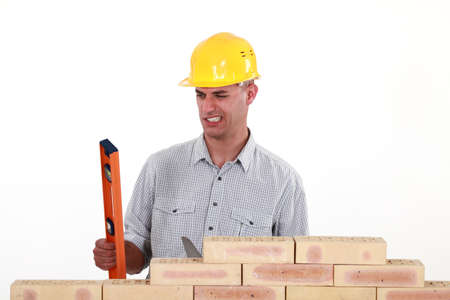 lopsided: Bricklayer with a spirit level