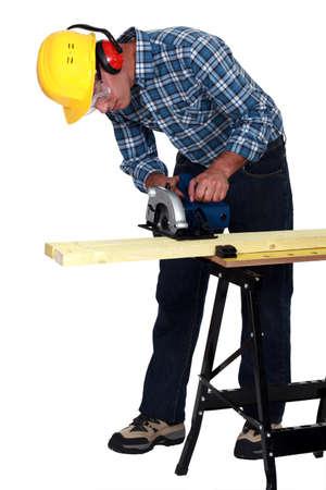 craftsman cutting a board photo