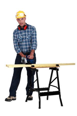 carpenter's sawdust: A carpenter with a circular saw.