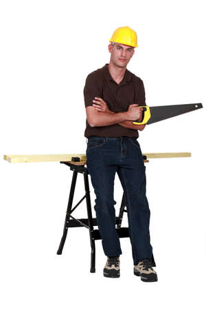 workbench: Carpenter with a handsaw Stock Photo