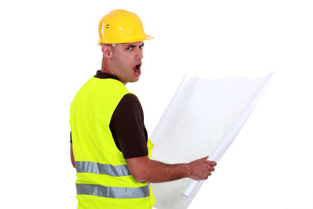 disbelief: Worker open mouthed in disbelief