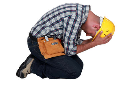 vexation: Construction worker on his knees