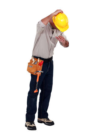 Tradesman suffering from a work injury photo