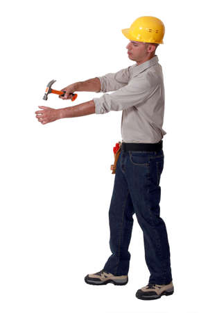 hammering: Builder hammering blank space
