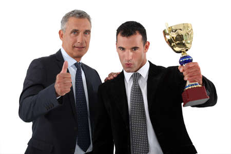 Businessmen with a trophy photo