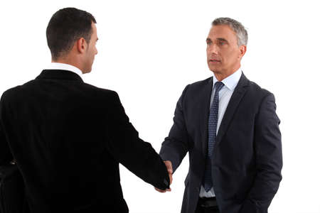 younger: A business handshake Stock Photo