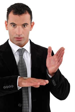 magic trick: Businessman doing a magic trick with money