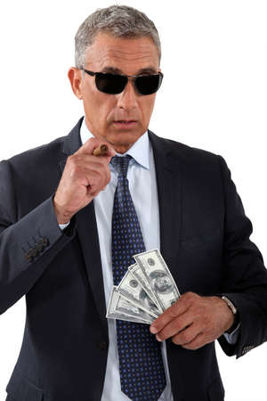 flaunt: Businessman with cigar and money Stock Photo